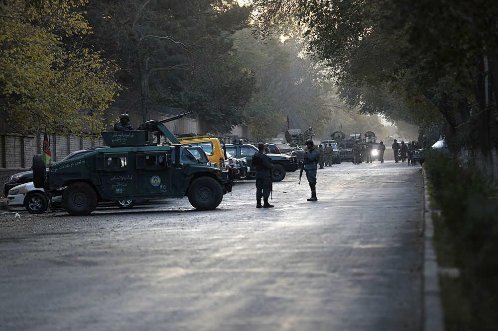 Afghan police patrol at the site of an attack at Kabul University in Kabul, Afghanistan, Monday, Nov. 2, 2020. The brazen attack by gunmen who stormed the university has left many dead and wounded in the Afghan capital. The assault sparked a hours-long gunbattle. (AP Photo/Rahmat Gul)