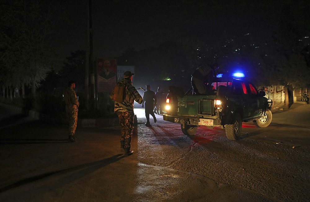 Afghan police work at the site of an attack at Kabul University in Kabul, Afghanistan, Monday, Nov. 2, 2020. The brazen attack by gunmen who stormed the Kabul University has left many dead and wounded in the Afghan capital. The assault sparked a hours-long gunbattle. (AP Photo/Rahmat Gul)