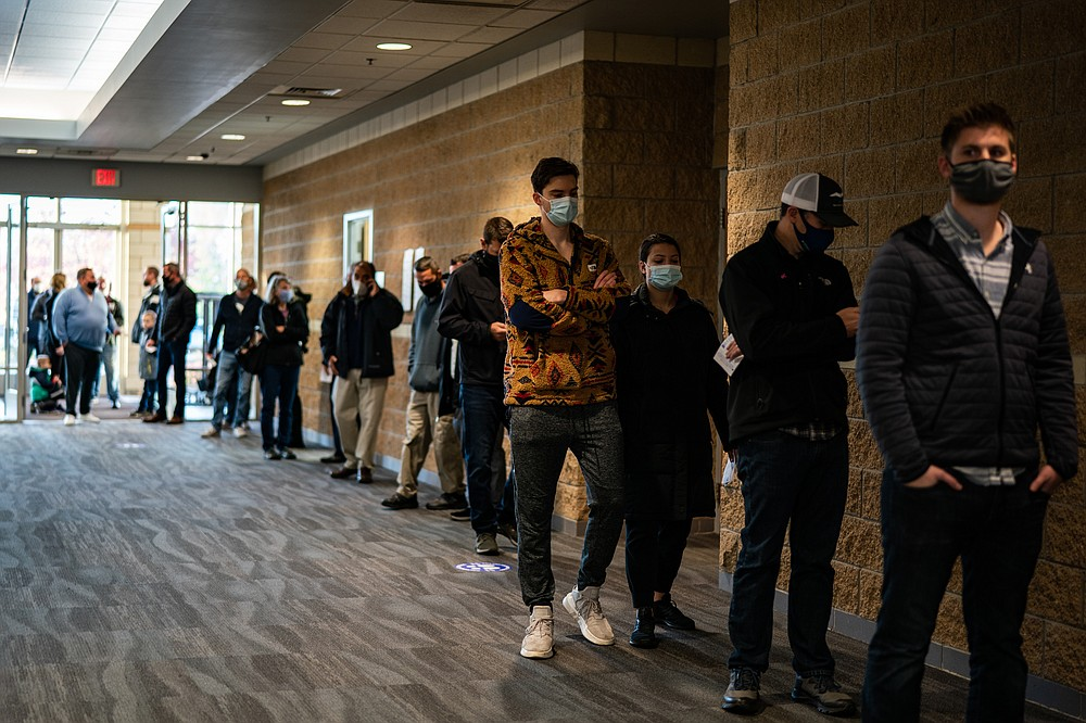 Voters wait in line at a polling location inside Ada Bible Church in Ada, Mich., on Tuesday. MUST CREDIT: Washington Post photo by Salwan Georges