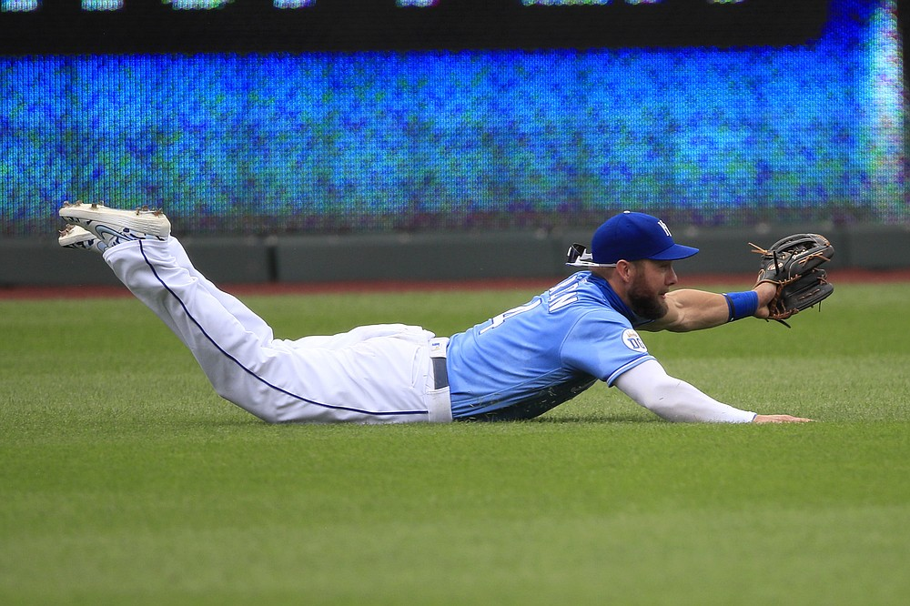 FILE - In this Aug. 9, 2020, file photo, Kansas City Royals left fielder Alex Gordon catches a fly ball hit by Minnesota Twins' Nelson Cruz during the first inning of a baseball game in Kansas City, Mo. Gordon won his eighth Gold Glove — and fourth straight — in his final major league season. (AP Photo/Orlin Wagner, File)