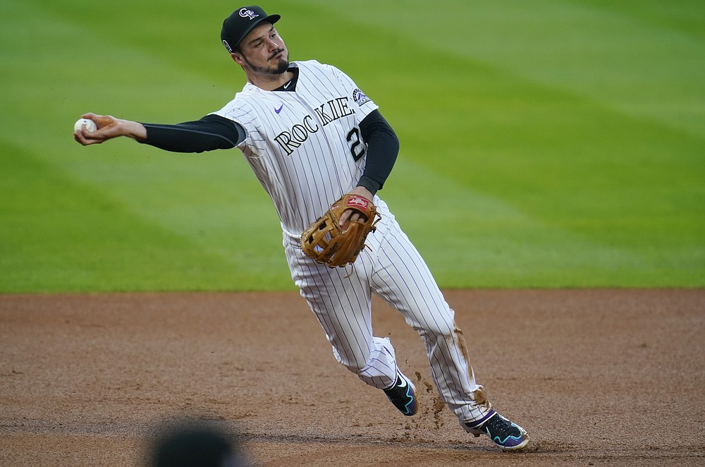 Colorado Rockies third baseman Nolan Arenado throws late to first base after fielding an infield single off the bat of Los Angeles Angels' Jared Walsh in the first inning of a baseball game Friday, Sept. 11, 2020, in Denver. (AP Photo/David Zalubowski)
