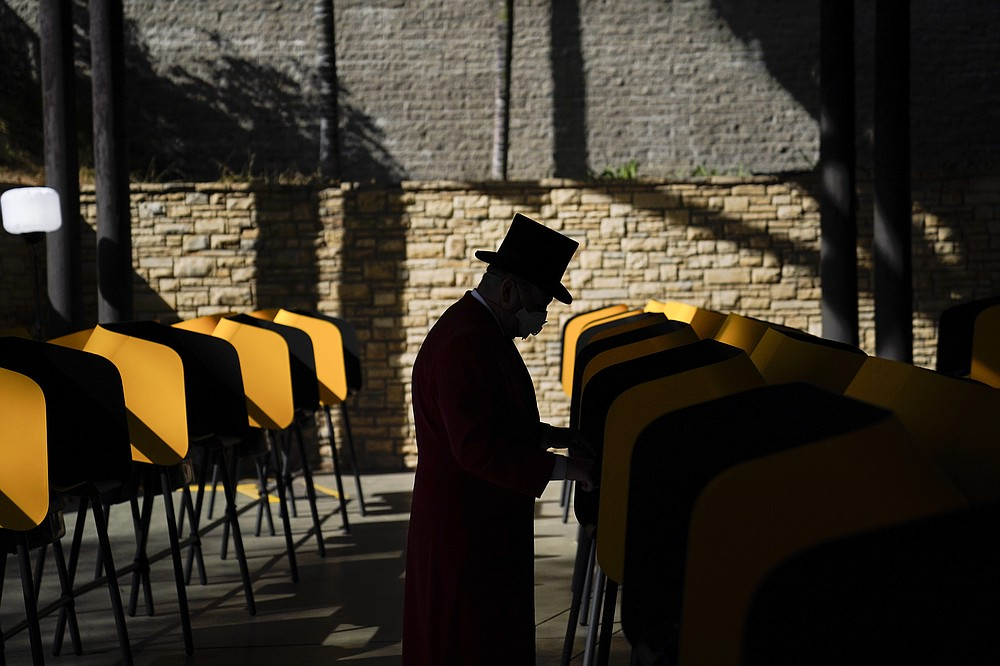Former Beverly Hills ambassador Gregg Donovan casts his ballot at a vote center set up at Hollywood Bowl in Los Angeles, Tuesday, Nov. 3, 2020.  (AP Photo/Jae C. Hong)