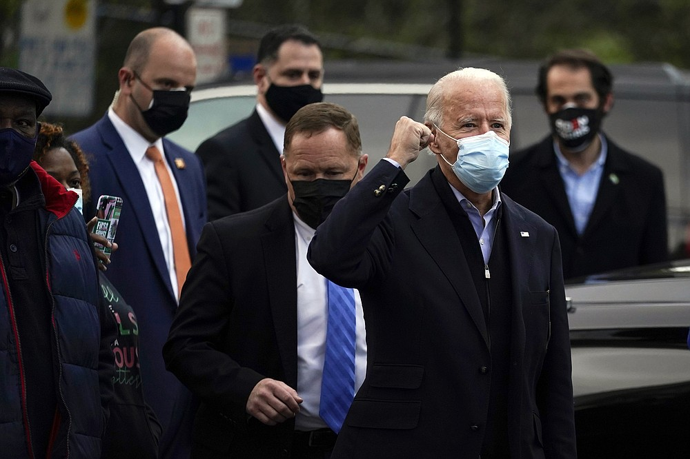 Democratic presidential candidate former Vice President Joe Biden visits with residents across the street from the Joseph R. Biden Jr. Aquatic Center in Wilmington, Del., Tuesday, Nov. 3, 2020. (AP Photo/Carolyn Kaster)