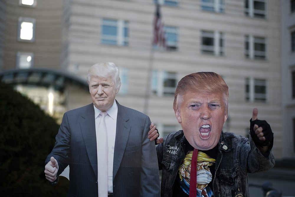 Gerd Lindner, as he said a huge fan of US President Donald Trump, poses near a paper mache effigy of Donald Trump with a Trump mask to support the President a day after the election, in the front of the United States embassy in Berlin, Germany, Wednesday, Nov. 4, 2020. (Photo/Markus Schreiber)