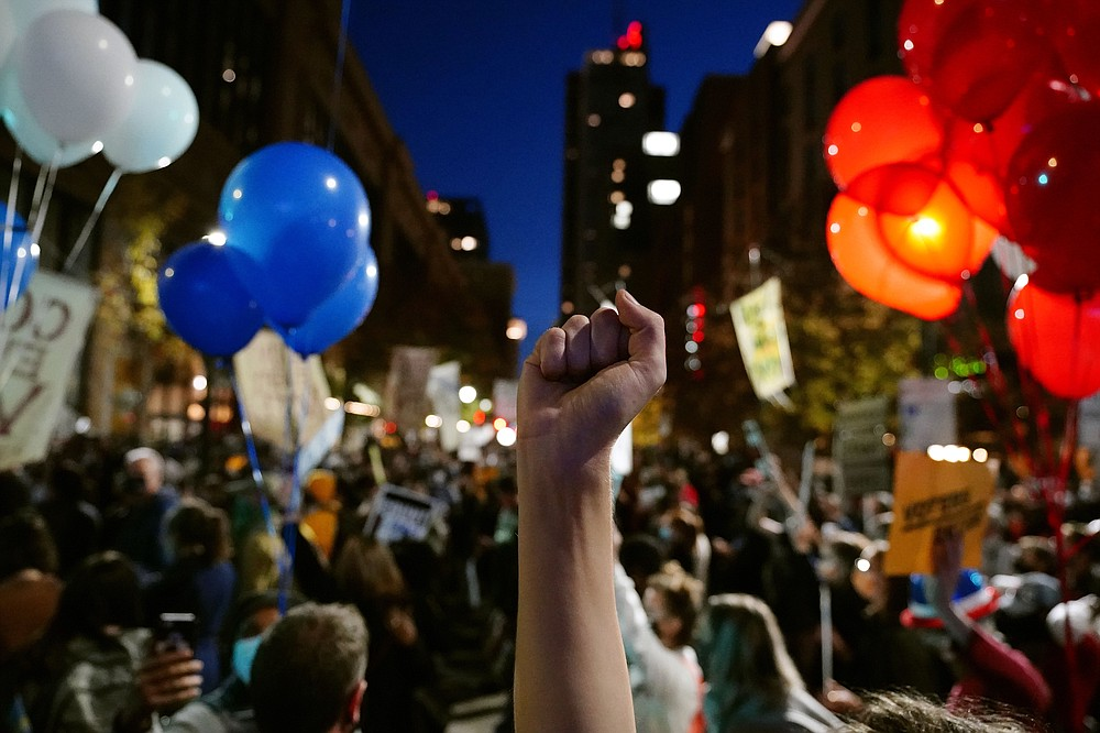 People urging that all votes be counted demonstrate outside the Pennsylvania Convention Center where votes are being counted, Thursday, Nov. 5, 2020, in Philadelphia, following Tuesday's election. (AP Photo/Matt Slocum)