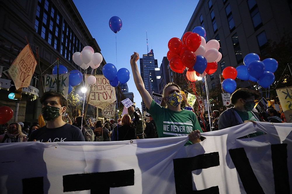 People urging that all votes be counted demonstrate outside the Pennsylvania Convention Center where votes are being counted, Thursday, Nov. 5, 2020, in Philadelphia, following Tuesday's election. (AP Photo/Rebecca Blackwell)