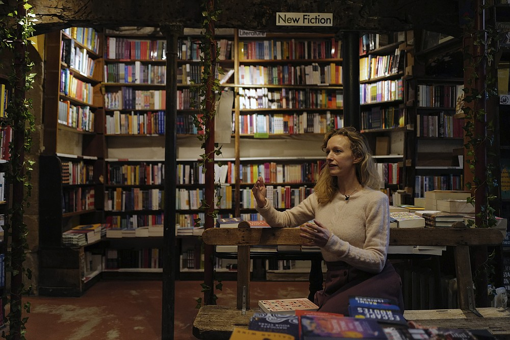 "Sylvia Whitman, proprietor of the English and American literature Shakespeare and Co. bookstore, attends an interview in Paris, France, Thursday, Nov. 05, 2020. Iconic Parisian bookshop Shakespeare and Co. has launched a support appeal to its readers after its owners say that coronavirus-linked losses, and a crippling months-long lockdown, have left the future of the veritable institution in doubt. ""We've been minus 80 percent since the first confinement in March, so at this point we've used all our savings,"" Sylvia Whitman, daughter of the shop's co-founder George Whitman, told the Associated Press. (AP Photo/Francois Mori)"