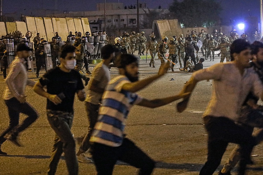 Security forces prevent anti-government protesters from setting up sit in tents in Basra, Iraq, Friday, Nov. 6, 2020.  (AP Photo/Nabil al-Jurani}