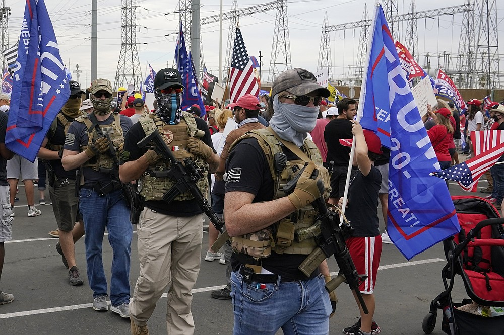 Supporters of President Donald Trump rally outside the Maricopa County Recorder's Office Friday, Nov. 6, 2020, in Phoenix. (AP Photo/Ross D. Franklin)