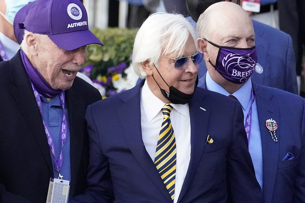 Trainer Bob Baffert, center, and others celebrate Authentic's win who was ridden by John Velazquez in the Breeder's Cup Classic horse race at Keeneland Race Course, in Lexington, Ky., Saturday, Nov. 7, 2020. (AP Photo/Michael Conroy)