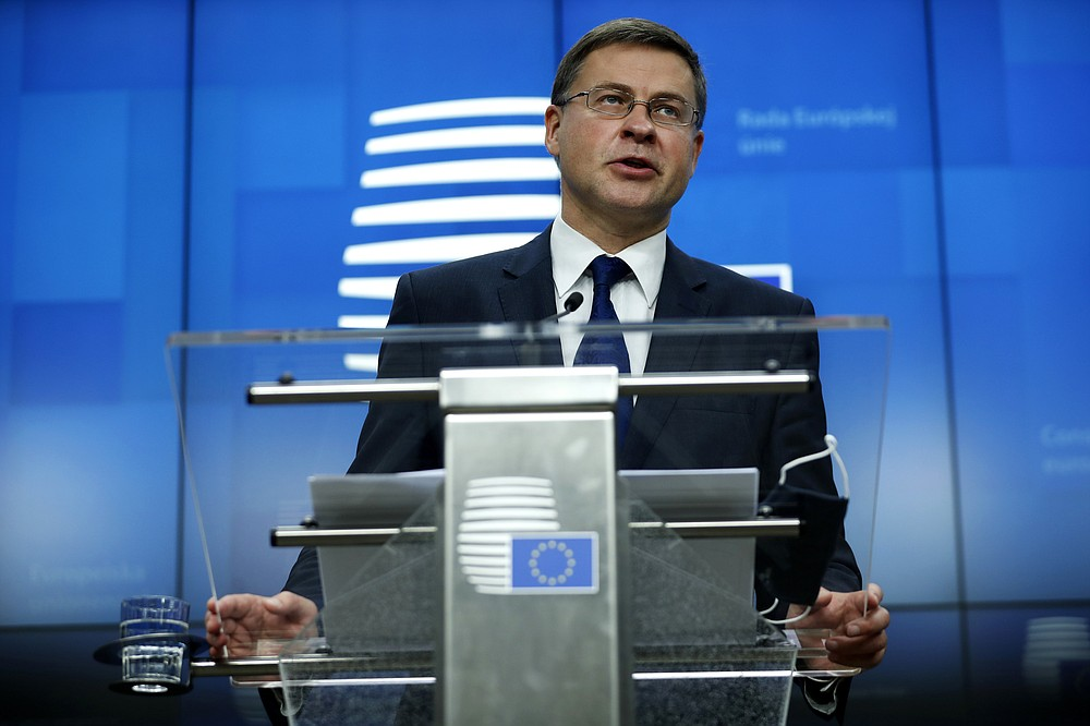 European Commission Vice-President Valdis Dombrovskis addresses a media conference after a meeting of EU trade ministers, in videoconference format, at the European Council building in Brussels, Monday, Nov. 9, 2020. European Union trade ministers on Monday exchanged views on the trade policy review and relations with China and the United States. (AP Photo/Francisco Seco, Pool)