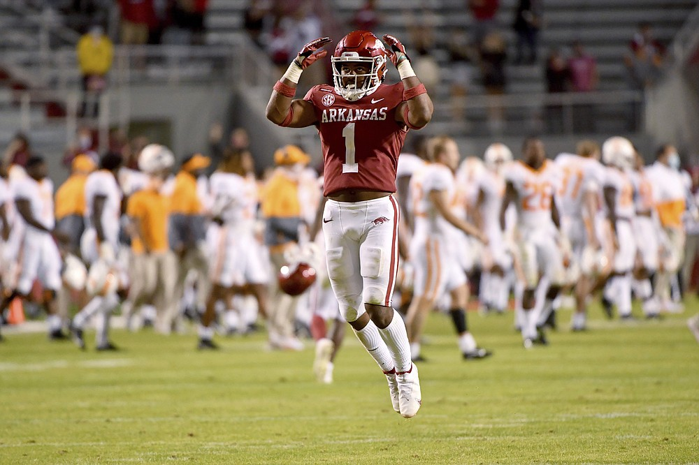 Arkansas defensive back Jalen Catalon (1) celebrates after Arkansas defeated Tennessee 24-13 in an NCAA college football game Saturday, Nov. 7, 2020, in Fayetteville, Ark. (AP Photo/Michael Woods)