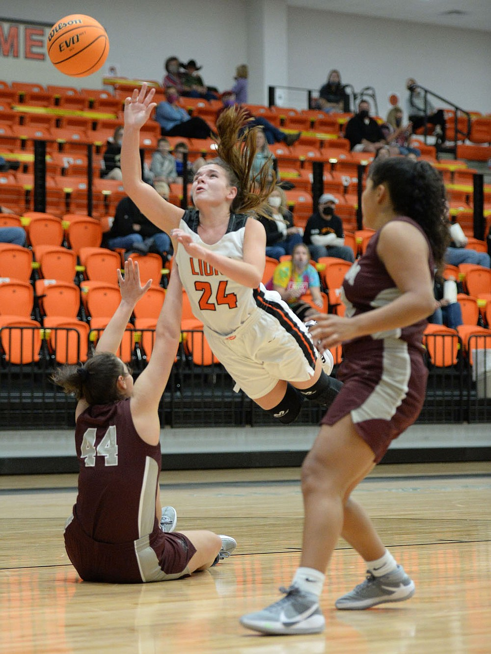 Andy Shupe/NWA Democrat-Gazette Gravette's Reese Hamilton (24) leaps Tuesday to score over Siloam Springs' Mia Hevener (44) during the first half of play in Gravette.