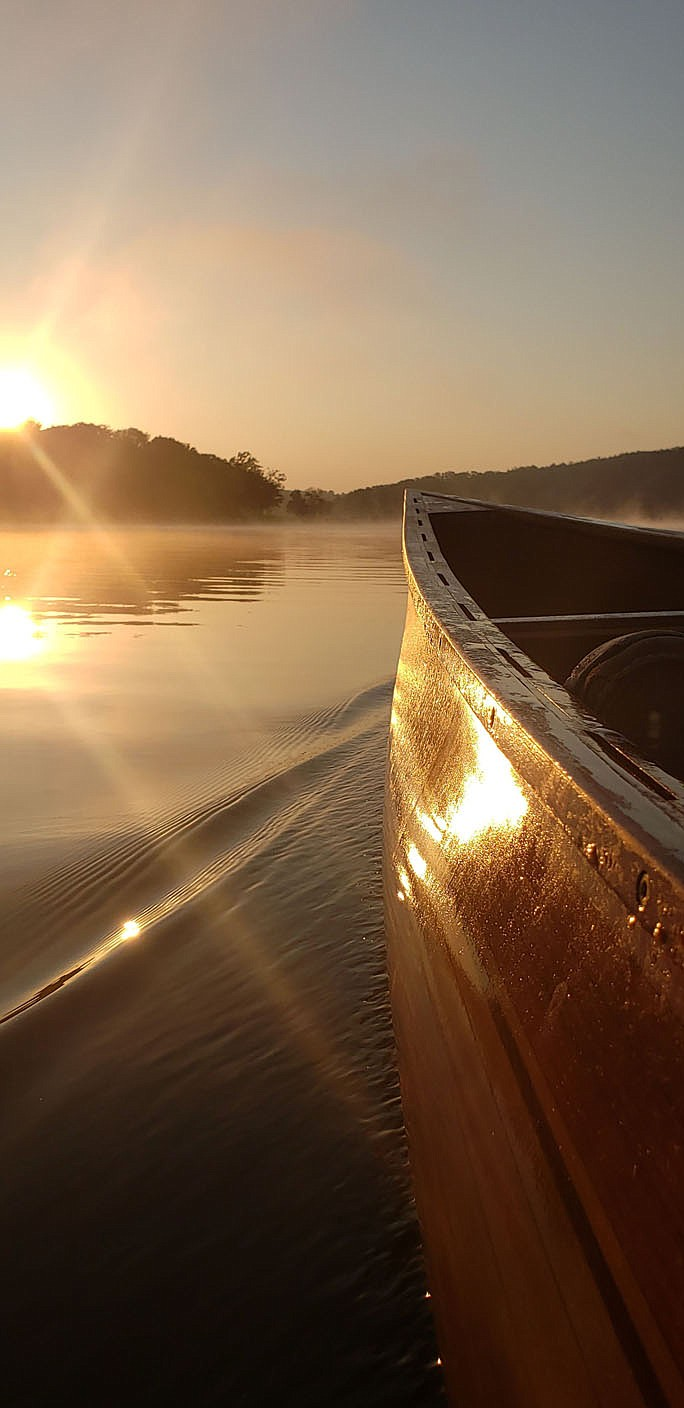 Sunrise lights up the bow of Eliasen's sleek canoe.  (Courtesy photo/Tony Eliasen)