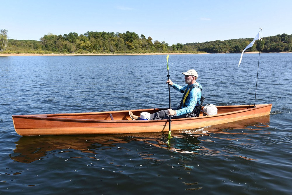 Tony Eliasen paddles near Horseshoe Bend Park on Beaver Lake during the first day, Oct. 2 2020, of his 120-mile canoe trip from the U.S. 412 bridge to downtown Branson.  (NWA Democrat-Gazette/Flip Putthoff)