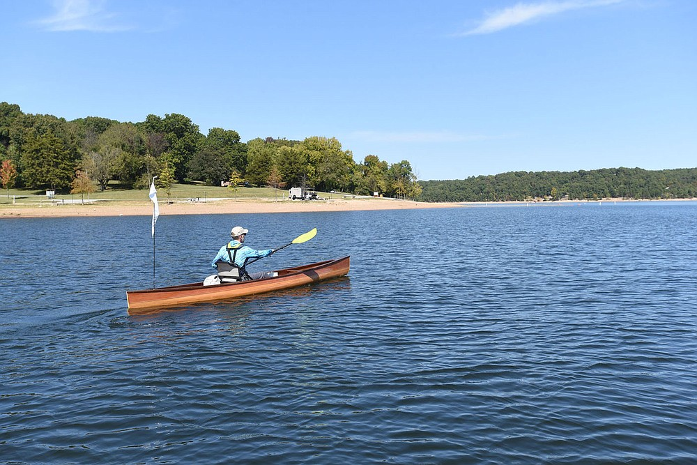 Eliasen makes his way past Horseshoe Bend park on Oct. 2 2020 at Beaver Lake.  (NWA Democrat-Gazette/Flip Putthoff)