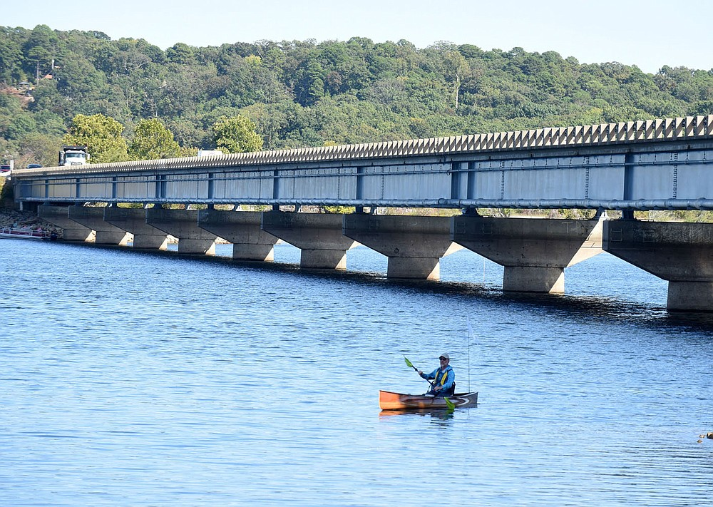 Eliasen wraps up the first day of his trip, taking out at the Arkansas 12 bridge after paddling 20 miles from the U.S. 412 bridge. (NWA Democrat-Gazette/Flip Putthoff)