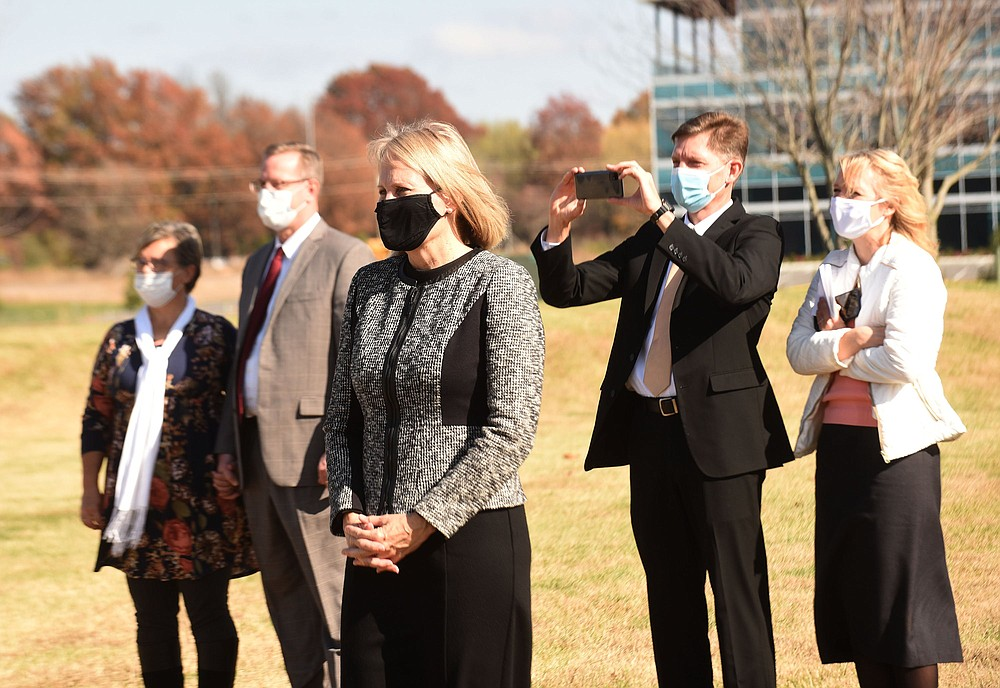Jan Saumweber, with the church's communications department , watches the ground breaking on Saturday Nov. 7 2020. (NWA Democrat-Gazette/Flip Putthoff)