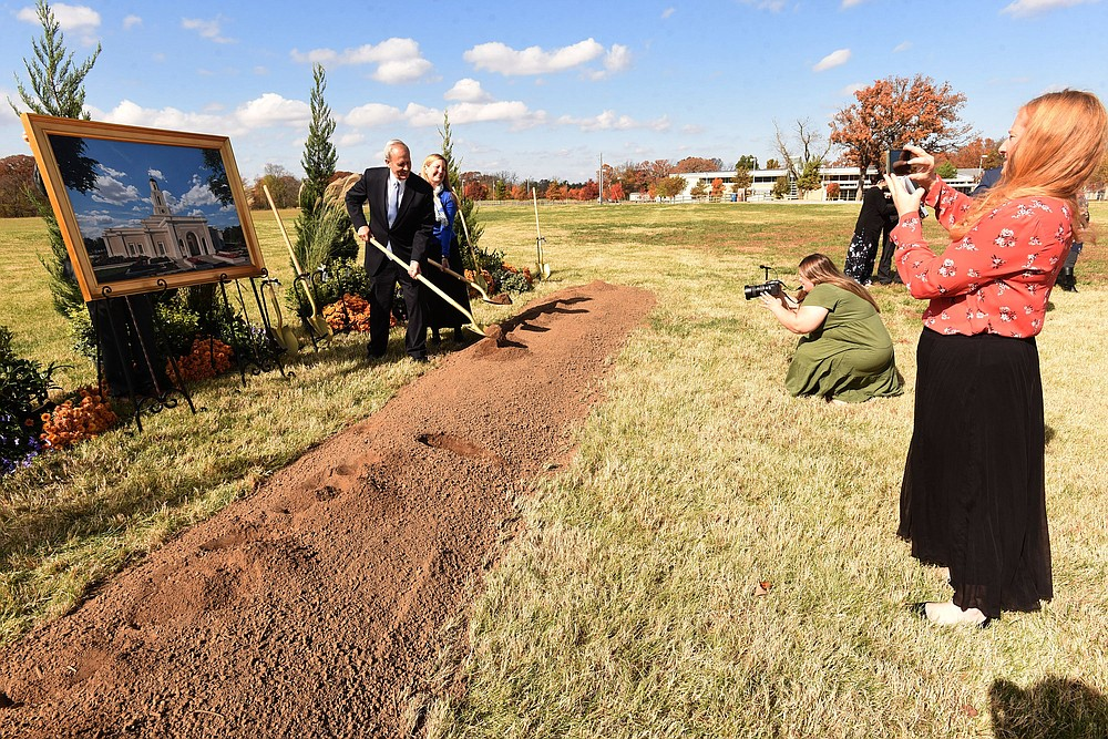 Elder David Harris and his wife, Lisa, pose for photos after the temple ground breaking on Saturday Nov. 7 2020. (NWA Democrat-Gazette/Flip Putthoff)
