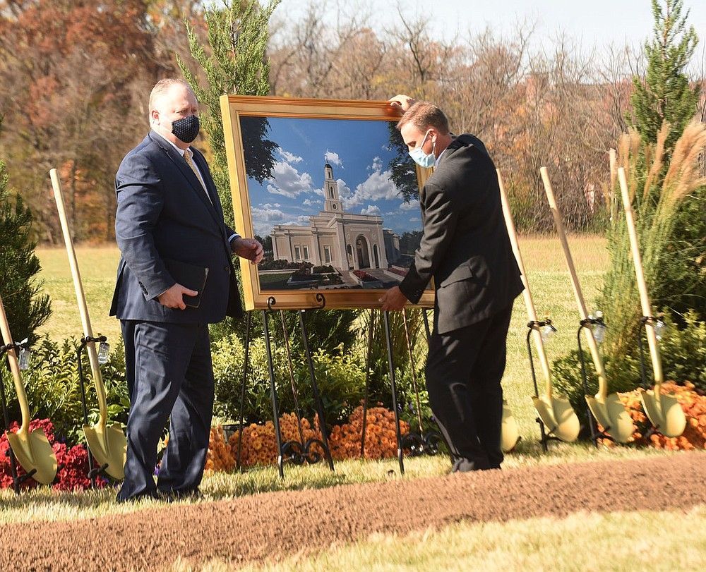 Artwork of Arkansas' first Mormon temple, to be built in Bentonville, is put in place Saturday Nov. 7 2020 for the groundbreaking. (NWA Democrat-Gazette/Flip Putthoff)