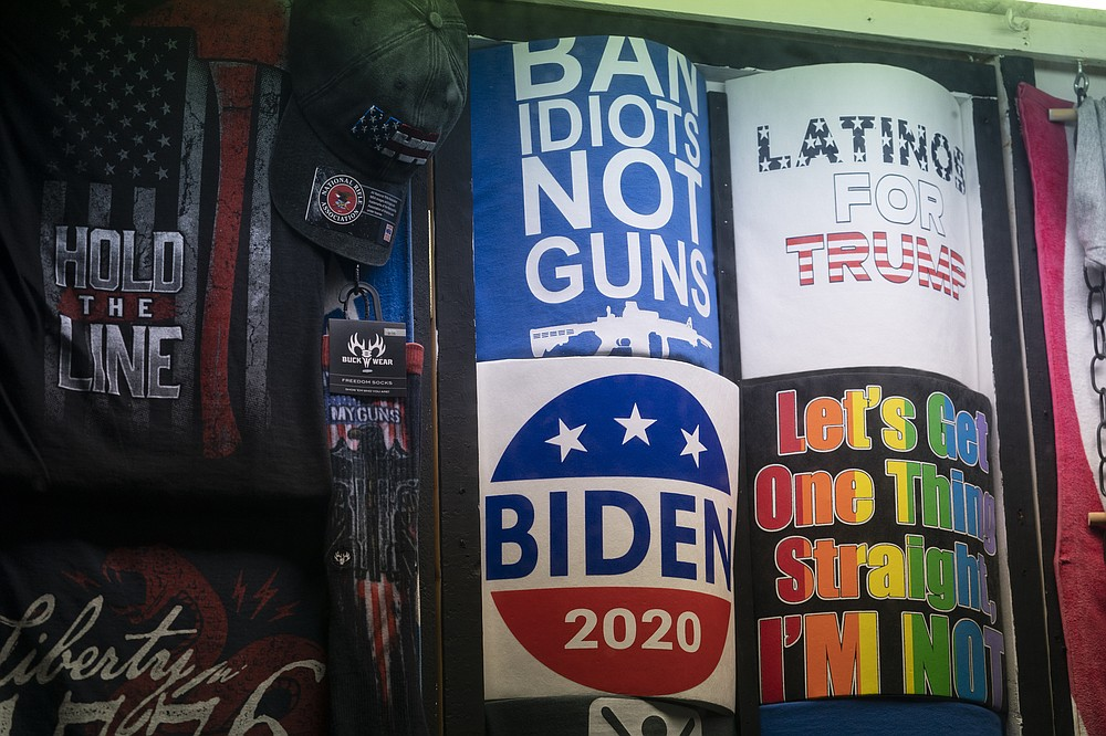 T-shirts in support of President-elect Joe Biden and President Trump are on display at T-Shirt World, Friday, Nov. 13, 2020, in Rehoboth Beach, Del. (AP Photo/Alex Brandon)