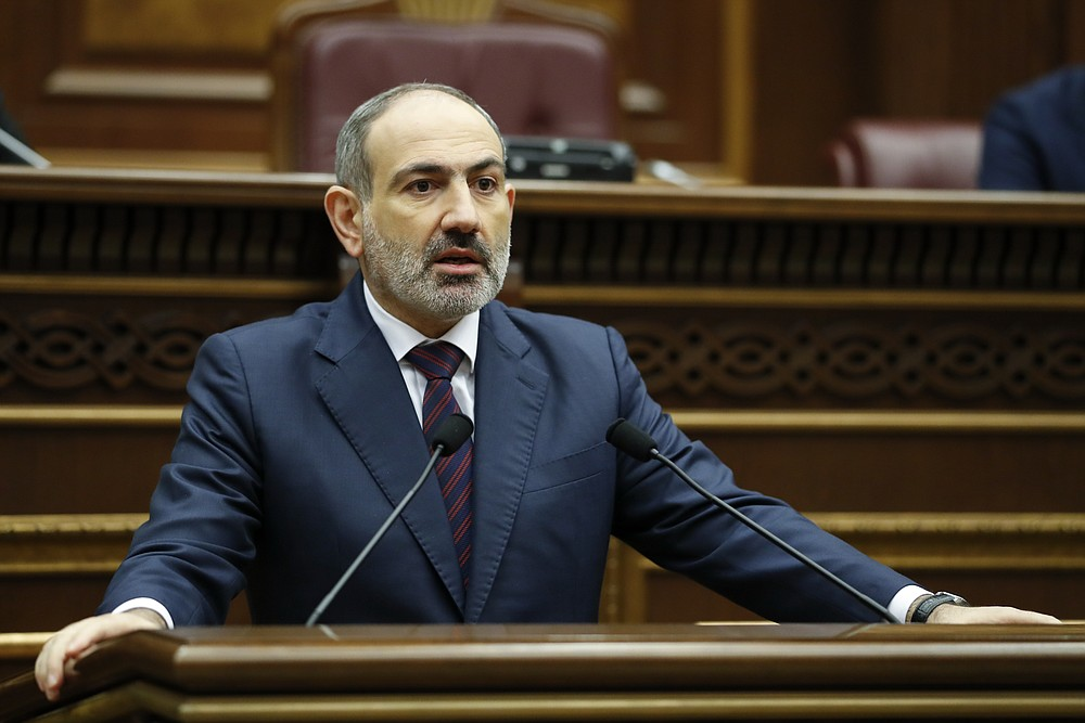 In this photo provided by the Armenian Prime Minister Press Service via PAN Photo, Armenian Prime Minister Nikol Pashinian answers to questions during his meeting with members of the National Assembly in Yerevan, Armenia, Monday, Nov. 16, 2020. (Tigran Mehrabyan, Armenian Prime Minister Press Service/PAN Photo via AP)