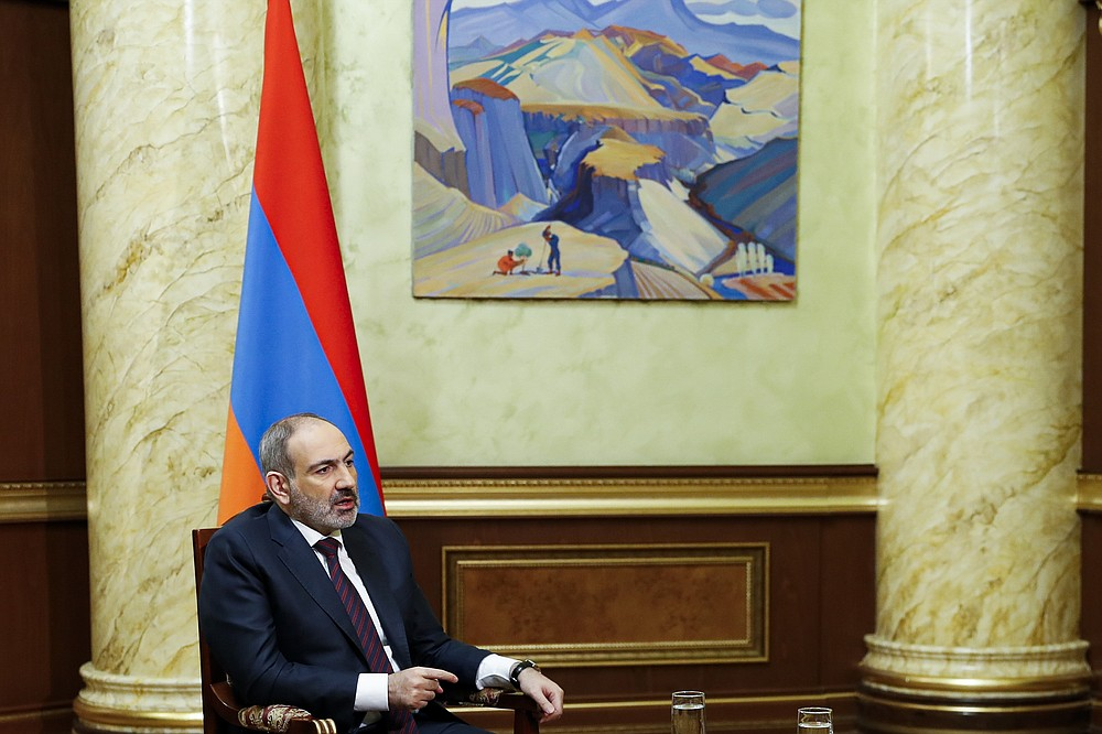 In this photo provided by the Armenian Prime Minister Press Service via PAN Photo, Armenian Prime Minister Nikol Pashinian speaks during his online news conference in Yerevan, Armenia, Monday, Nov. 16, 2020. (Tigran Mehrabyan, Armenian Prime Minister Press Service/PAN Photo via AP)