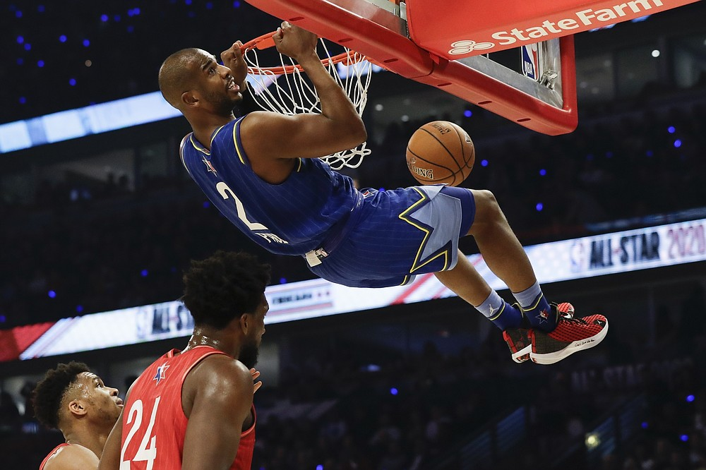 FILE - Chris Paul of the Oklahoma City Thunder dunks during the first half of the NBA All-Star basketball game in Chicago, in this Feb. 16, 2020, file photo. A person with knowledge of the situation says All-Star guard Chris Paul is being traded from the Oklahoma City Thunder to the Phoenix Suns, where he'll play alongside one of the league's most dynamic young scorers in fellow All-Star Devin Booker. The Thunder are acquiring Ricky Rubio, Kelly Oubre, Jalen Lecque, Ty Jerome and a first-round pick that will be conveyed sometime between 2022 and 2025, said the person who spoke to The Associated Press on condition of anonymity because the trade had not been finalized by the league. (AP Photo/Nam Huh, File)