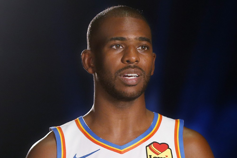FILE - Oklahoma City Thunder guard Chris Paul (3) is interviewed during an NBA basketball media day in Oklahoma City, in this Monday, Sept. 30, 2019, file photo. A person with knowledge of the situation says All-Star guard Chris Paul is being traded from the Oklahoma City Thunder to the Phoenix Suns, where he'll play alongside one of the league's most dynamic young scorers in fellow All-Star Devin Booker. The Thunder are acquiring Ricky Rubio, Kelly Oubre, Jalen Lecque, Ty Jerome and a first-round pick that will be conveyed sometime between 2022 and 2025, said the person who spoke to The Associated Press on condition of anonymity because the trade had not been finalized by the league. (AP Photo/Sue Ogrocki, File)