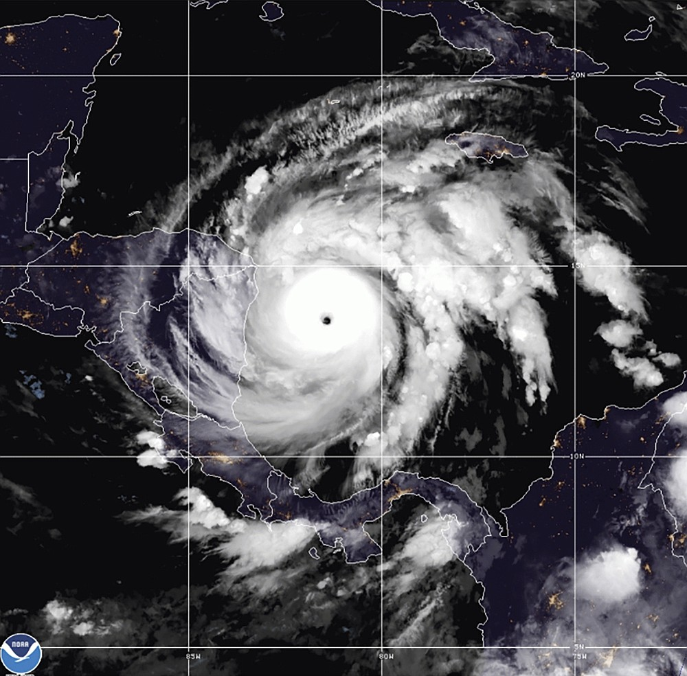 This satellite image made available by NOAA shows Hurricane Iota in the North Atlantic Ocean on Monday, Nov. 16, 2020, at 07:11 EST.  (NOAA via AP)