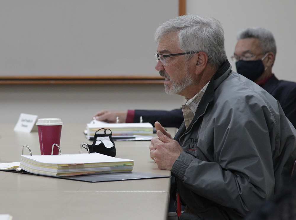 """Urban Renewal Agency board member Kirby Mouser presses Executive Director Maurice Taggart on next steps to acquire property in the downtown area, including the possibility of using eminent domain. """"This is a big step but it's one we're going to have to take,"""" Mouser said."""