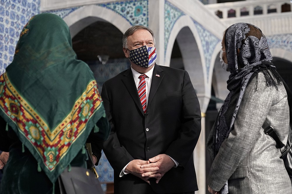 Secretary of State Mike Pompeo, centre, tours the Rustem Pasha Mosque in Istanbul, Tuesday, Nov. 17, 2020. Pompeo's stop in Turkey is focused on promoting religious freedom and fighting religious persecution, which is a key priority for the U.S. administration, officials said. (AP Photo/Patrick Semansky, Pool)