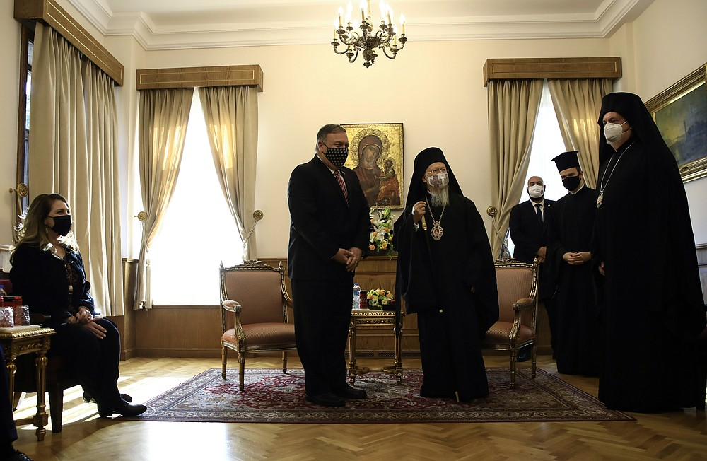 Ecumenical Patriarch Bartholomew I, center right, the spiritual leader of the world's Orthodox Christians, meets with US Secretary of State Mike Pompeo, center left, as Pompeo 's wife Suzan, left, looks on in Istanbul, Tuesday, Nov. 17, 2020. Pompeo is visiting Turkey as part of a seven-nation trip to Europe and the Middle East. (Umit Bektas/Pool via AP)