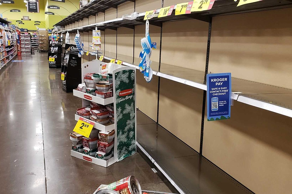 Shelves in the toilet paper aisle at a Fred Meyer store sit empty in Happy Valley, Ore., Saturday, Nov. 14, 2020, the day after Gov. Kate Brown announced new restrictions on businesses that included capacity limits in grocery stores. A surge of new coronavirus cases in the U.S. is sending people back to stores to stockpile again, leaving shelves bare and forcing retailers to put limits on purchases. (Samantha Swindler/The Oregonian via AP)