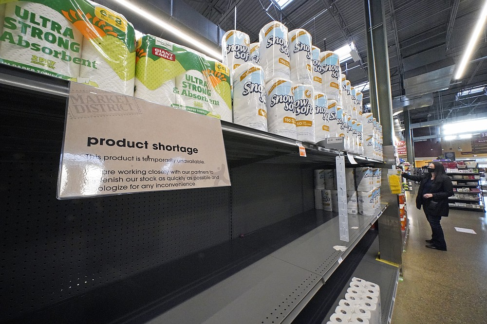 Paper products are in short supply on the shelves of a Pittsburgh market on Tuesday, Nov. 17, 2020. A surge of new coronavirus cases in the U.S. is sending people back to stores to stockpile again, leaving shelves bare and forcing retailers to put limits on purchases. (AP Photo/Gene J. Puskar)