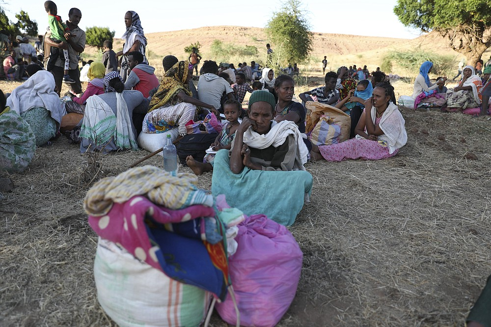 Ethiopian refugees gather in Qadarif region, easter Sudan, Tuesday, Nov. 17, 2020. The U.N. refugee agency says Ethiopia's growing conflict has resulted in thousands fleeing from the Tigray region into Sudan as fighting spilled beyond Ethiopia's borders and threatened to inflame the Horn of Africa region. (AP Photo/Marwan Ali)