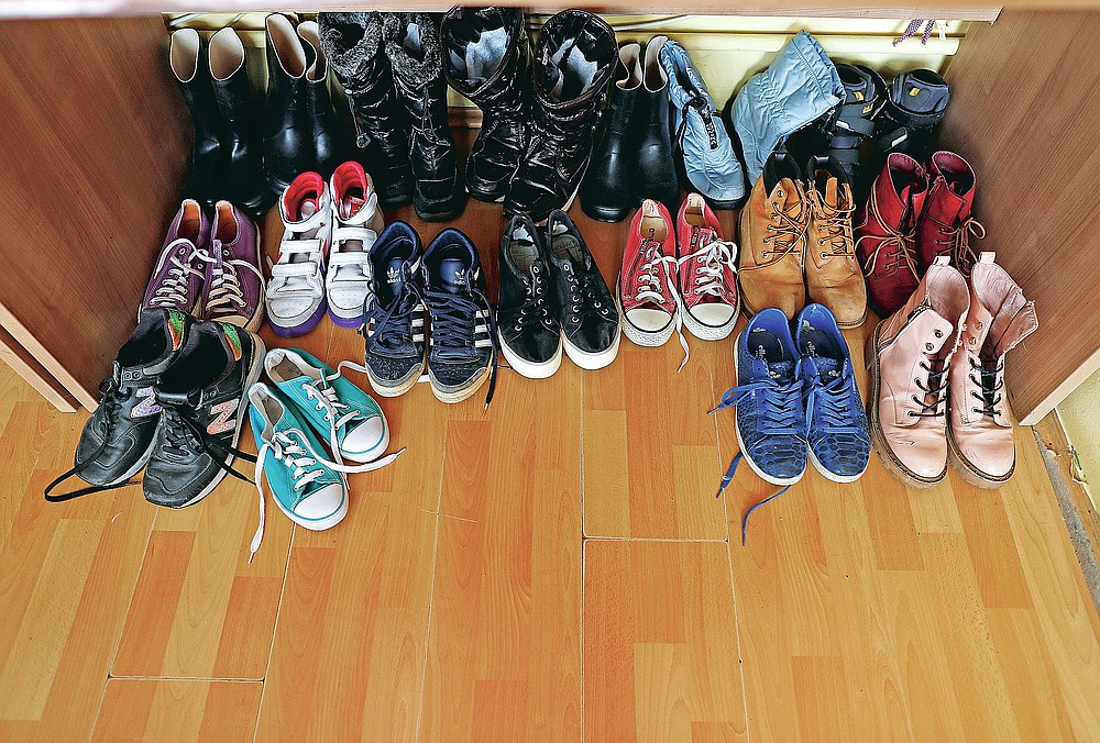 In this photo taken Wednesday, Oct. 28, 2020, shoes donated by the general public, at Svratiste, or Roadhouse, Belgrade's first daily drop-in center for street children, in Serbia. For years, a small house tucked away in a Belgrade residential area has been an oasis of warmth and comfort for the Serbian capital's most vulnerable inhabitants  - street children. The Roadhouse drop-in center has served the basic needs of hundreds of children who often have nowhere else to wash, warm up or properly eat.  (AP Photo/Darko Vojinovic)