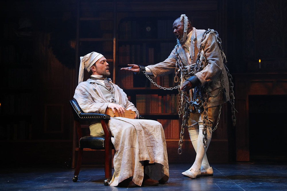 """The TheatreSquared Amy Herzberg- and Bob Ford-original, """"A Christmas Carol,"""" returns for its second year with in-person shows and will be available to stream at home Dec. 2-27. James Taylor Odom starred as Ebenezer Scrooge in last year's production to James Bowen's Jacob Marley. Information: theatre2.org. (Courtesy Photo)"""