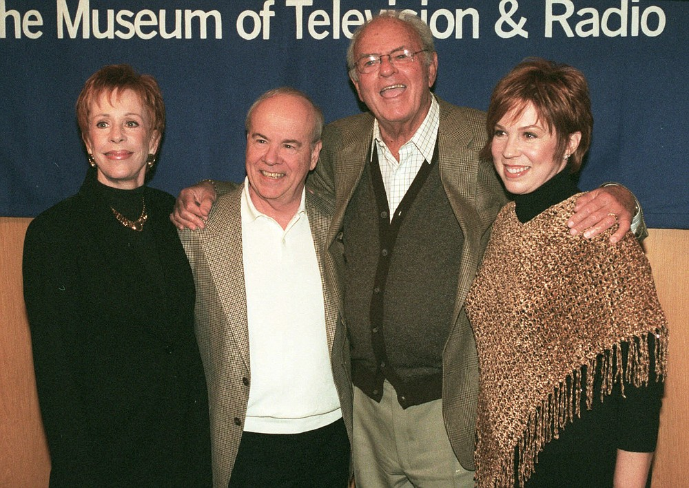 "REMOVES REFERENCE TO HULU - FILE - Cast members of ""The Carol Burnett Show"", from left, Carol Burnett, Tim Conway, Harvey Korman and Vicki Lawrence pose for a photo before attending a discussion of the former television show at the Director's Guild Theater in the Hollywood section of Los Angeles, on March 3, 2000.  Episodes of ""The Carol Burnett Show"" are available on streaming services like Tubi and The Roku Channel.  (AP Photo/Neil Jacobs, File)"