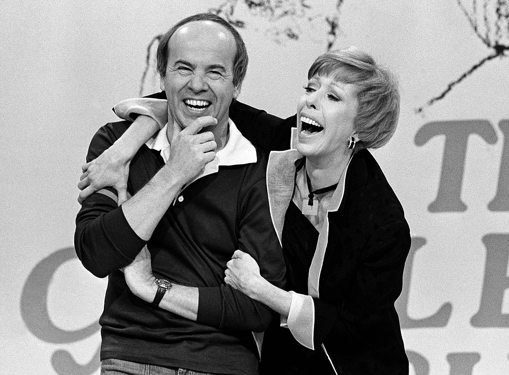 "REMOVES REFERENCE TO HULU - FILE - Carol Burnett, right, shares a laugh with Tim Conway during a taping of her final show on March 19, 1978, in Los Angeles. Episodes of ""The Carol Burnett Show"" are available on streaming services like Tubi and The Roku Channel.  (AP Photo/ George Brich, File)"