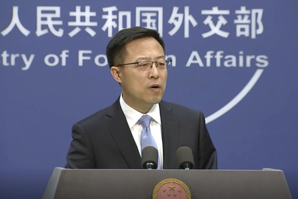 """In this image from video, Chinese Foreign Ministry spokesperson Zhao Lijian speaks at a briefing in Beijing Tuesday, Nov. 17, 2020. Lijian said Australia should do something """"to promote mutual trust and cooperation"""" between the two countries, in response to the call from Australia's trade minister Simon Birmingham for dialogue and discussion with China to stop the trade disruptions over tensions. Australia is the first country to ban China's Huawei from its 5G network and Canberra led a global effort calling for an independent probe into the origins of the COVID-19 pandemic, which first emerged in China's Wuhan city. (AP Photo)"""