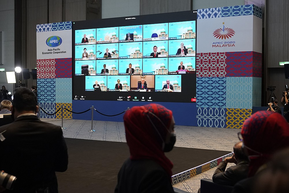 Monitors showing the opening leaders attending the first virtual Asia-Pacific Economic Cooperation (APEC) leaders' summit, hosted by Malaysia, in Kuala Lumpur, Malaysia, Friday, Nov. 20, 2020. (AP Photo/Vincent Thian)