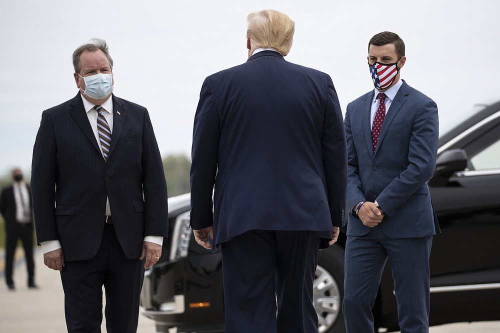 FILE - In this May 21, 2020, file photo, President Donald Trump is greeted by Kurt Heise, left, Supervisor of Plymouth Township, Mich., and Speaker Lee Chatfield, of the Michigan House of Representatives after stepping off Air Force One as he arrives at Detroit Metro Airport in Detroit. President Donald Trump summoned Michigan's Republican legislative leaders Chatfield and Senate Majority Leader Mike Shirkey, to the White House for a meeting Friday, Nov. 20, amid a GOP push to overturn the certification of Democrat Joe Biden's victory in the battleground state. (AP Photo/Alex Brandon, File)