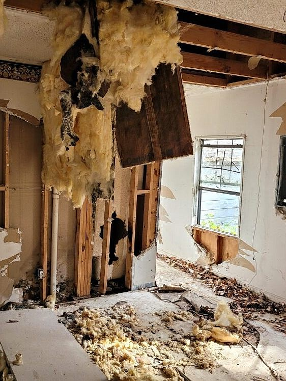 The interior of the house at 1206 W. 18th Ave. shows significant damage, making the property a prime candidate for removal as the structural components of the house have deteriorated to the point that renovation would likely be a prohibitively expensive undertaking. The house is scheduled for demolition on Tuesday by the Urban Renewal Agency. (Photo courtesy Pine Bluff Urban Renewal Agency)
