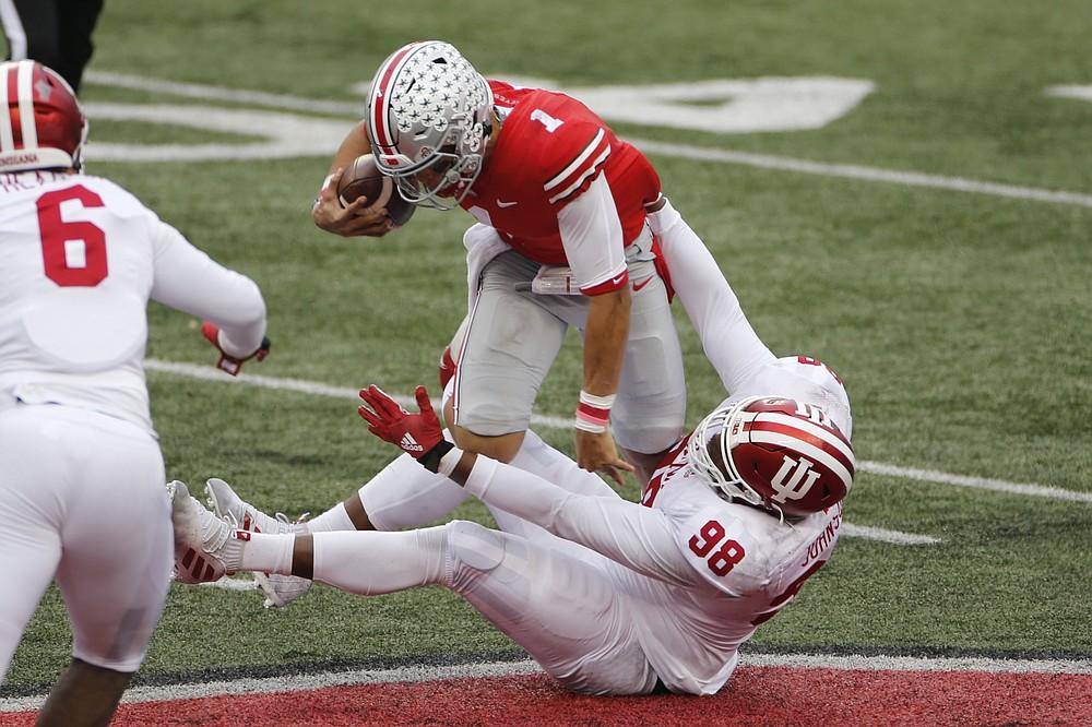 Indiana defensive lineman Jerome Johnson, bottom, sacks Ohio State quarterback Justin Fields during the first half of an NCAA college football game Saturday, Nov. 21, 2020, in Columbus, Ohio. (AP Photo/Jay LaPrete)