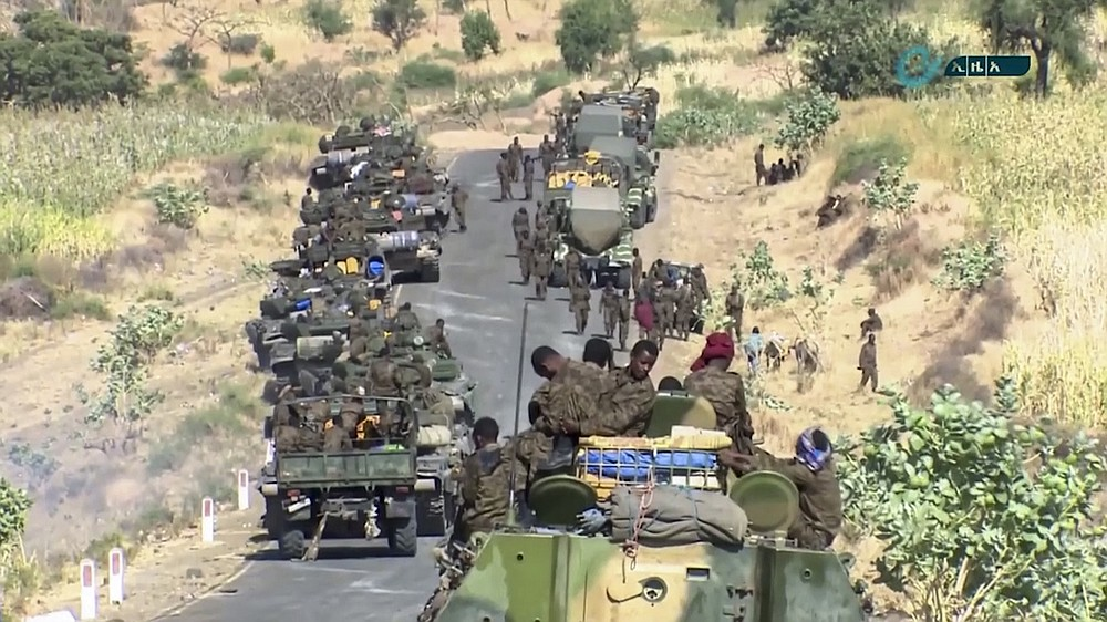 """This image made from undated video released by the state-owned Ethiopian News Agency on Monday, Nov. 16, 2020 shows Ethiopian military gathered on a road in an area near the border of the Tigray and Amhara regions of Ethiopia. Ethiopia's prime minister Abiy Ahmed said in a social media post on Tuesday, Nov. 17, 2020 that """"the final and crucial"""" military operation will launch in the coming days against the government of the country's rebellious northern Tigray region. (Ethiopian News Agency via AP)"""