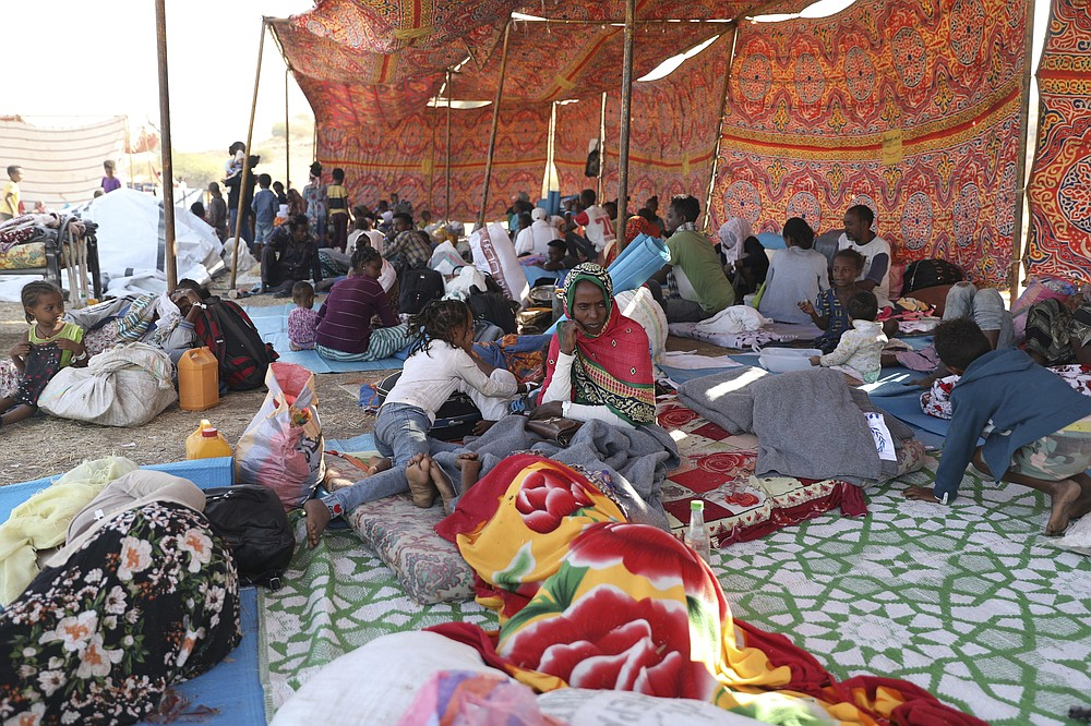 Ethiopian refugees gather in Qadarif region, easter Sudan, Friday, Nov 20, 2020. Thousands of Ethiopians fled the war in Tigray region into Sudan. (AP Photo/Marwan Ali)