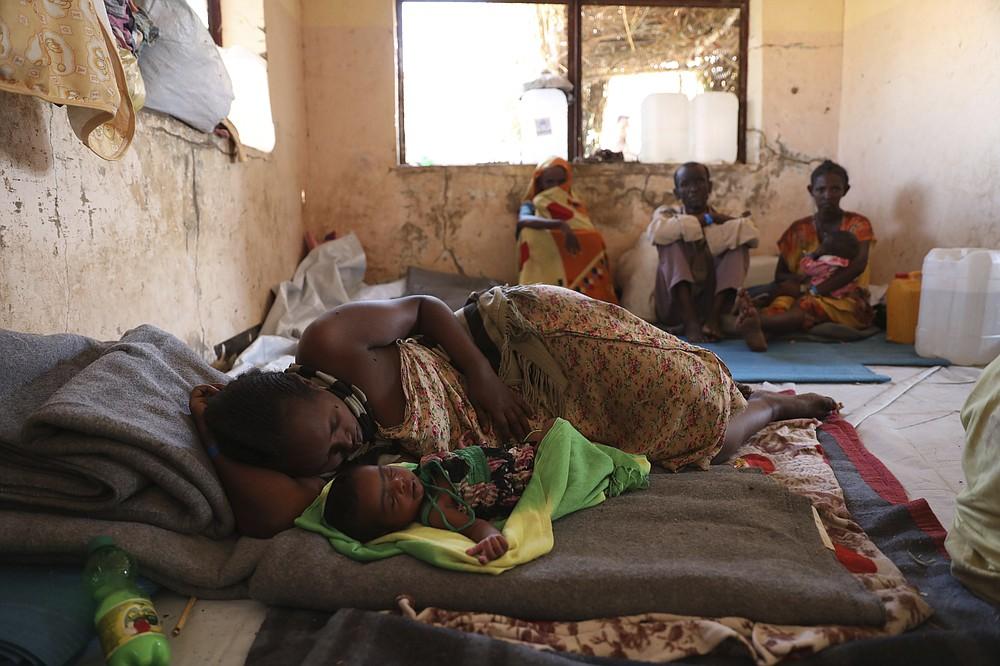 Ethiopian refugees rest in Qadarif region, easter Sudan, Friday, Nov 20, 2020. Thousands of Ethiopians fled the war in Tigray region into Sudan. (AP Photo/Marwan Ali)