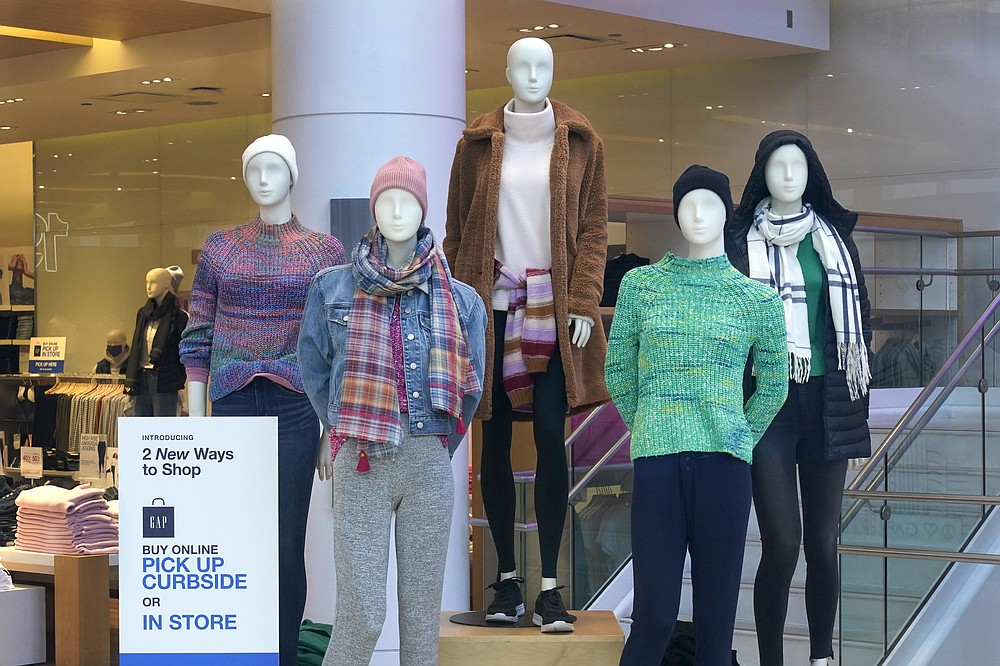 Mannequins stand on display Wednesday, Nov. 18, 2020, at The Gap store on Michigan Avenue in Chicago. The accelerating surge of coronavirus cases across the U.S. is causing an existential crisis for America's retailers and spooking their customers just as the critically important holiday shopping season nears.(AP Photo/Charles Rex Arbogast)
