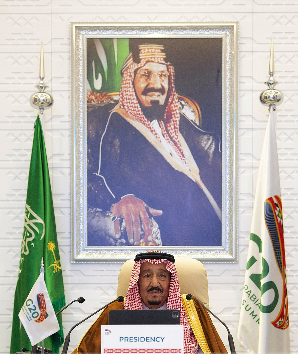 In this handout image provided by G20 Riyadh Summit, Saudi King Salman gives his opening remarks at a virtual G20 summit hosted by Saudi Arabia and held over video conference amid the COVID-19 pandemic, in Riyadh, Saudi Arabia, Saturday, Nov. 21, 2020. (G20 Riyadh Summit via AP)